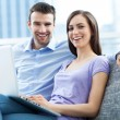 Stock Photo: Couple on sofa with laptop