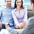 Stock Photo: Couple meeting with financial adviser