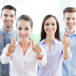 Coworkers showing thumbs up — Stock Photo