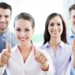 Coworkers showing thumbs up — Foto de Stock