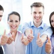 Stock Photo: Coworkers showing thumbs up