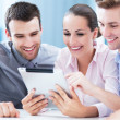Coworkers looking at digital tablet — Stockfoto