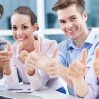 Coworkers showing thumbs up — Stock Photo #27662953