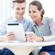 Couple using digital tablet — Stock Photo