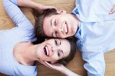 Couple lying on the floor — Stock Photo