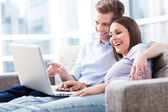 Business couple with laptop — Stock Photo