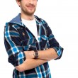 Stock Photo: Young man with arms folded