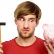 Man about to break a piggybank — Stock Photo