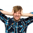 Upset man holding head with hands — Stock Photo #27693689