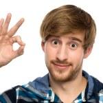 ok işareti yapma genç adam — Stok fotoğraf #27693691