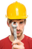 Construction worker holding wrench — Stock Photo