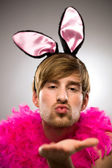 Man in bunny ears blowing kiss — Stock Photo