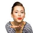Young woman blowing a kiss — Stock Photo #27700231
