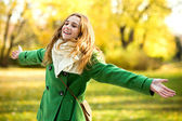 Woman holding autumn leaf — Stock Photo