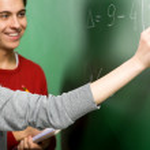 Students Doing Math on Chalkboard — Stock Photo #27713243