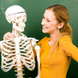 Female student with skeleton — Stock Photo