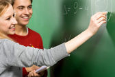 Students Doing Math on Chalkboard — Stock Photo
