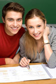 Students doing homework — Stock Photo