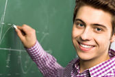 Student Doing Math on Chalkboard — Stock Photo