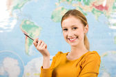 Female student in front of world map — Stock Photo