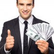 Businessman holding dollar bills — Stok fotoğraf