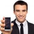 Businessman showing his mobile phone — Stock Photo #27806607