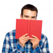 Young guy holding book — Stock Photo
