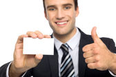 Man with business card showing thumbs up — Stock Photo