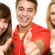 Young with thumbs up — Stock Photo #27812593