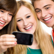 Friends taking picture of themselves — Stock Photo