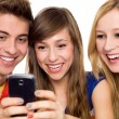 Friends looking at mobile phone — Stock Photo #27813331