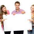 Three young holding blank poster — Stock Photo