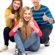 Friends with thumbs up — Stock Photo