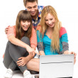 Young looking at laptop — Stockfoto