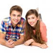 Stock Photo: Young couple lying down