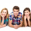 Three young friends lying down — Stock Photo #27815185