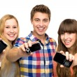 Friends holding mobile phones — Stock Photo #27815773