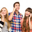 Friends holding mobile phones — Stock Photo #27815887