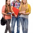 Students holding books — Stock Photo