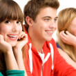Three young smiling — Stock Photo