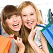 Girls with shopping bags — Stock Photo #27817189