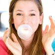 Stock Photo: Young girl blowing bubble gum