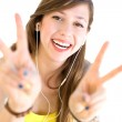 Young woman showing peace sign — Stock Photo #27817761