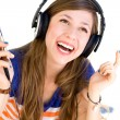 Young woman listening to music — Stock Photo #27818277