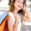 Attractive young woman shopping — Stockfoto