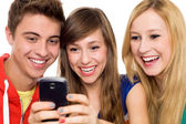 Friends looking at mobile phone — Stock Photo