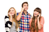 Friends holding mobile phones — Stock Photo