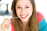 Girl playing with chewing gum — Stock Photo