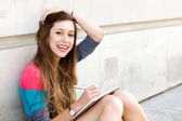 Teenage girl writing — Stock Photo