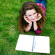 Girl doing her homework outdoors — Foto de Stock
